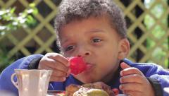Boy appetizingly eats a tomato. Boy has dinner. Stock Footage