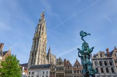 Statue of Brabo, throwing the giant's hand into the Scheldt River and the Cat Stock Photos