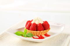 Stock Photo of Pastry crust filled with fresh raspberries and cream