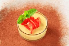 Stock Photo of Small dish of custard topped with strawberry