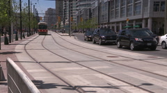 Toronto urban transit new and old streetcars on TTC Queens Quay route Stock Footage