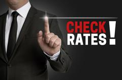 Check rates touchscreen is operated by businessman - stock photo