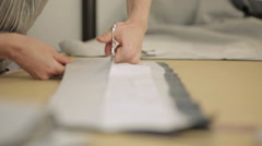 Pattern cutting with a piece of fabric on a table. Stock Footage