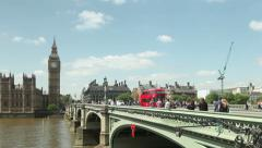 Panning view of Big Ben, Westminster and London Buses - stock footage