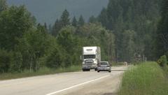 Transportation, transport trucks x3, long lens Stock Footage