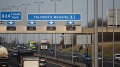 Heavy traffic traveling on the A1/M motorway at rushour Leeds, UK Stock Footage