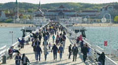 People on the pier in Sopot, Poland Stock Footage