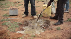 Mixing water and cement to make land marker, Africa, Kenya Stock Footage