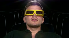 Stock Video Footage of boy sitting at cinema, Close up. 3D stereo glasses
