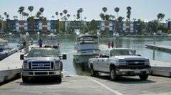 Two Trucks on Boat Ramp Stock Footage