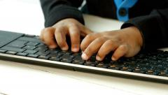 Small black fingers to press on the keyboard. Stock Footage