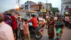 Indian traffic. Pedestrians, rickshaws, motorcycles moving erratically. Stock Footage