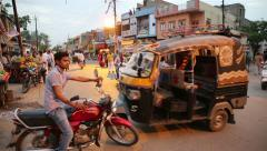 Indian traffic. Pedestrians, rickshaws, motorcycles moving erratically. Stock Footage
