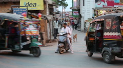 Stock Video Footage of Indian traffic. Pedestrians, rickshaws, motorcycles moving erratically.