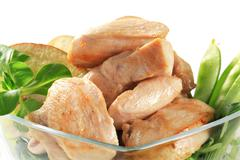 Cooked chicken breast fillets with snow peas and apple - stock photo
