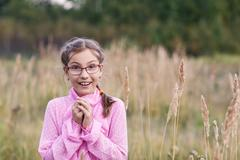 Adorable girl in glasses - stock photo