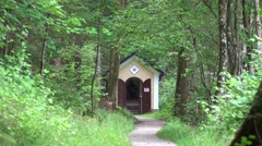 4k Small mountain forest church building zoom out Hallstatt Stock Footage