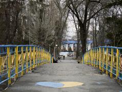 Patriotic blue-yellow bridge in Ukraine - stock photo