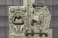 Wrought iron door and lock Stock Photos