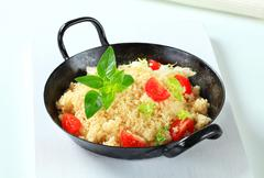 Couscous with salad greens and tomato Stock Photos