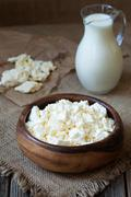 Stock Photo of Homemade traditional cottage cheese ogranic dairy product with milk in rustic