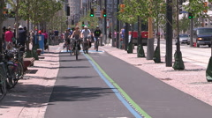 Toronto new bike lanes and bike paths and cyclists using them Stock Footage