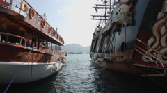 Two wooden ships moored at the pier. Marmaris, Turkey. 4K RAW video record Stock Footage