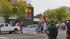 Military Color guard Gay Pride parade pass The Center GLBT community Denver, CO Stock Footage