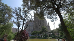 Sagrada Familia seen from Plaza Gaudi, Barcelona Stock Footage
