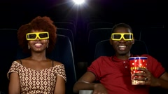 Stock Video Footage of Happy African American couple, watching movie In theatre, Close up. 3D stereo