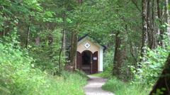 Small mountain forest church building zoom out Hallstatt Stock Footage