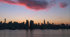 Orange and pink clouds above the Midtown Manhattan skyline Stock Footage