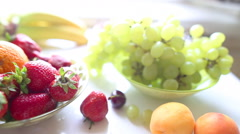 Different Summer fruits on a table Stock Footage