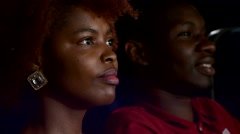Happy African American couple, watching movie In theatre, Close up - stock footage