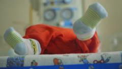 Newborn unrecognizable baby in perinatal center, maternity hospital Stock Footage