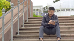 Artist Sketches On His Tablet On The Steps Of The Conservatory Of Flowers (4K) - stock footage