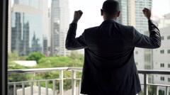 Successful businessman raising arms, power symbol  HD Stock Footage