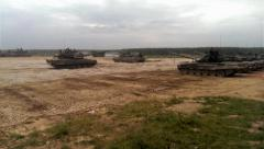 Tanks go and stop at the military training ground Stock Footage