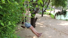 Young Girl On A Swing With Seaview Non Focus Backgroud - stock footage