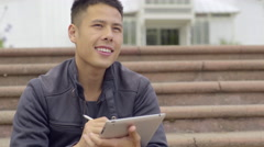 Artist Sits In Golden Gate Park And Draws On His Tablet (4K) Stock Footage