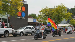 Scooter club in front of the Center GLBT community during gay pride parade Stock Footage