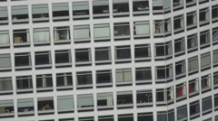 ULTRA HD 4K Tilt up office building skyscraper residential block crowded window  Stock Footage