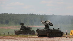 Armored vehicles in the polygon. SA-13 Gopher. SA-19 Grison. Stock Footage