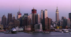 Light purple sky over the Midtown Manhattan skyline in the late afternoon Stock Footage