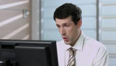 Clerk working at the computer. Manager in the office. Pleased clerk. Stock Footage