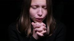 Teen girl praying Stock Footage