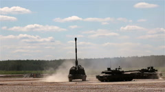 Russian armored  vehicles in the polygon. M1990 Farm, T-80U Stock Footage