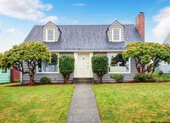 Authentic gray house with yard. Stock Photos