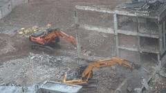 ULTRA HD 4K Aerial view excavator industrial machine work destruct building day Stock Footage