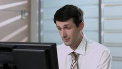 Tired clerk. Clerk rubs his tired eyes. Businessman working on the computer. Stock Footage